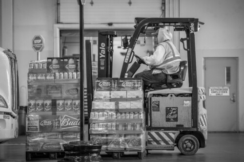 Cases of beer being moved by a fork lift